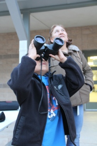 Learning how to use binoculars.